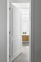 An open door to a bathroom.