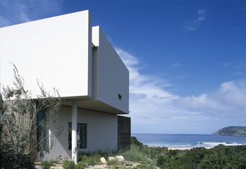Side view of modern white geometric house.