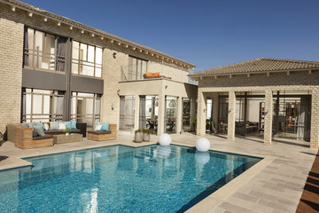 Exterior of a modern villa with a pool