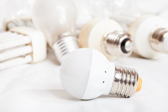 energy saving LED lamp and several old light bulbs