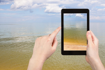 calm surface of Azov Sea on tablet pc