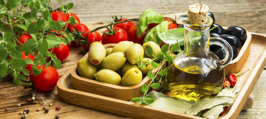 Mediterranean ingredients with olive oil and olives, spices and