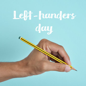 text left-handers day and the hand of a lefty