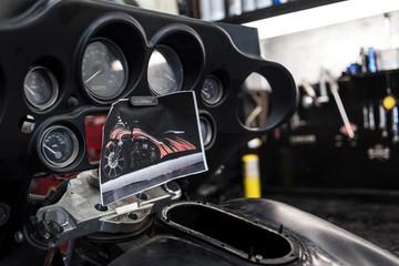 Motorbike dashboard with photo of futuristic bike