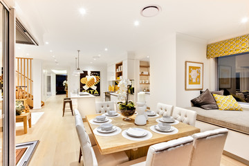 Dining set up with wooden table  in the living room