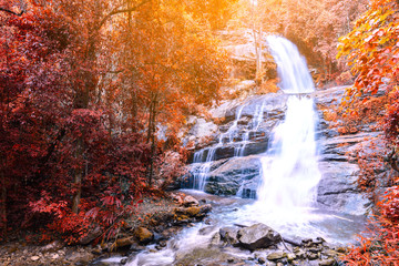 Beautiful autumn waterfall in deep forest in Chiang Mai, Thailand.