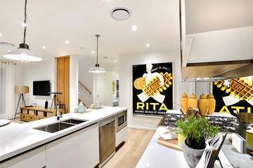 Modern kitchen closeup with white walls and hanging lamps