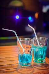Blue cocktail on bar background