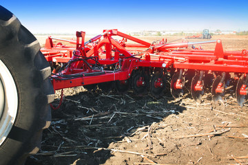 Agricultural machinery handles the ground in a field