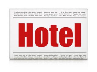 Tourism concept: newspaper headline Hotel