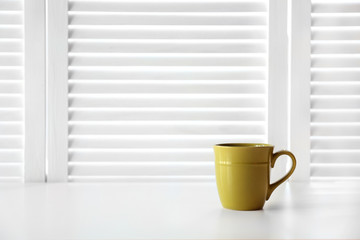 Cup on white folding screen background
