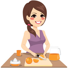 Woman cutting oranges with knife preparing healthy organic juice