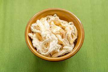 close up in dried squid on green  background