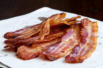 Fried crispy bacon on paper.