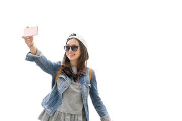 Beautiful Asian traveler woman taking selfie with the copy space, isolate on white background, travel concept