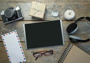 Digital tablet with travel flat lay objects