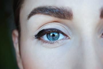 Blue eye of a teen