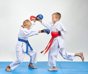 Paired exercise of karate are training athletes with overlays on his hands
