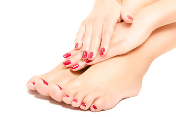 Photo sur Aluminium Manicure Beautiful foot and hands with red manicure