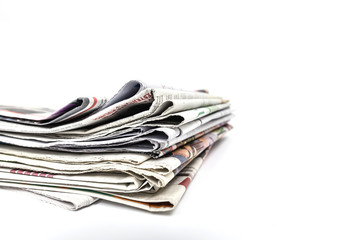 Stock of newspaper on white backgroung.Image with clipping path.