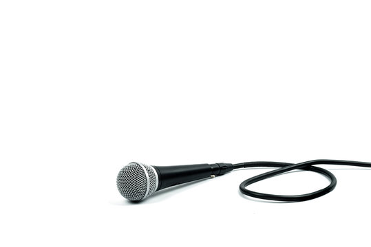 Microphone with cable on white background