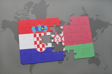 puzzle with the national flag of croatia and belarus on a world map background.
