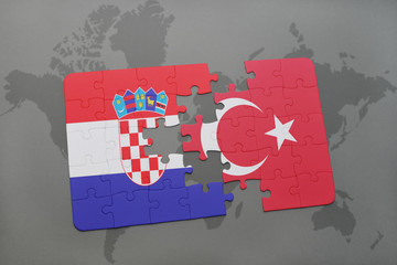 puzzle with the national flag of croatia and turkey on a world map background.