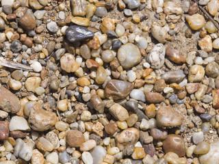 Abstract pebble stones background texture macro, selective focus
