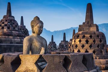 Papiers peints Edifice religieux Ancient Buddha statue and stupa at Borobudur temple in Yogyakart