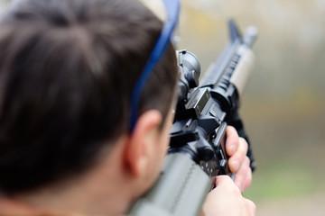 civil man aiming through the scope