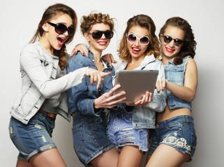 five hipster girls friends taking selfie with digital tablet