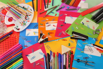 Background of school notebooks, pencils, pens, staplers, buttons and other school supplies