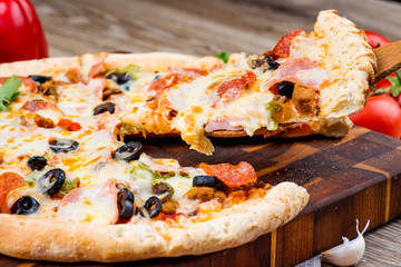 Hot pizza on wooden background