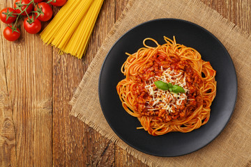 Delicious spaghetti served on a black plate Wall mural