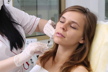 Rejuvenation procedure in beauty clinic, filler injection.