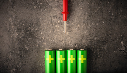 AA batteries and cable for measure of power and energy level. Concept image of electrical objects, electricity and technology.