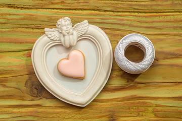 White angel photo frame with white thread and decorative heart