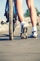 Cyclist's feet and a bike tire