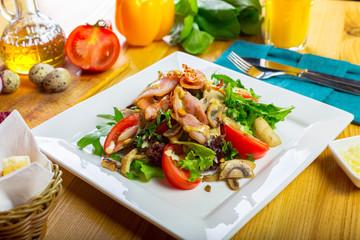 Warm mushroom salad with chilli and tomatoes