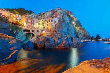 Papiers peints Ligurie Night view of Manarola fishing village, seascape in Five lands, Cinque Terre National Park, Liguria, Italy.
