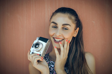 Attractive young photographer smiling