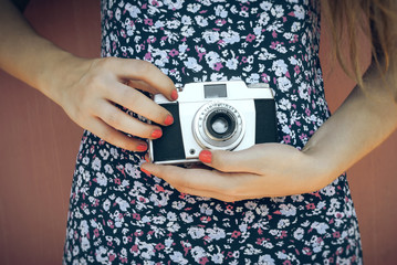 Old camera in her hands