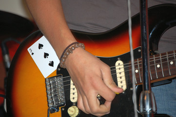 Hands and Guitar of local musician at benefit for sick child