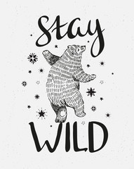 "Hand drawn dancing bear. Vector sketch illustration with stylish lettering ""stay wild"""