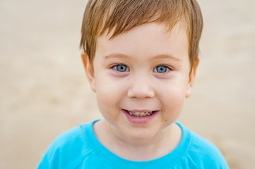 Happy little Caucasian boy (3 year old) with blue eyes.