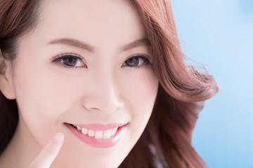 Beautiful woman with health teeth