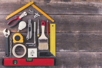 house renovation and improvement DIY tools on old wooden backgro