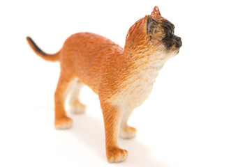 Toy cat from plastic on a white background.