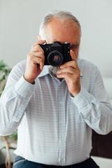 Senior man taking pictures