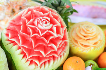 Closed up view of carved watermelons. Dining fruit presentation on the table. Selective focusand shallow DOF.